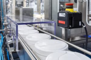 Xpander, Stuffer, liquids filling, sealing, capping Monoblock for rolls in canisters